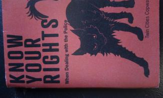 Know Your Rights booklet with black sabocat.