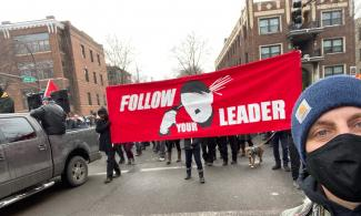 """Follow Your Leader"" banner at a Saturday counter-protest"