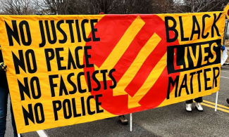 Banner: No Justice, No Peace, No Fascists, No Police, Black Lives Matter